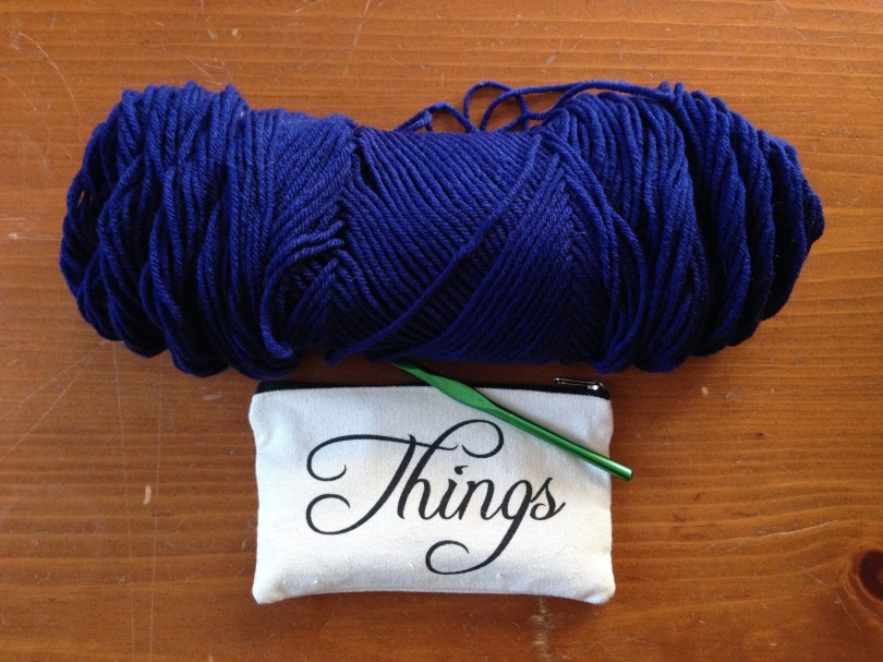 navy yarn and a size K crochet needle to start